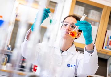Laboratory technician testing liquid